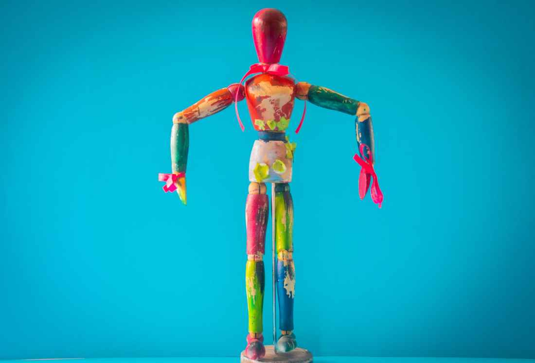 selective focus photo of multicolored wooden mannequin